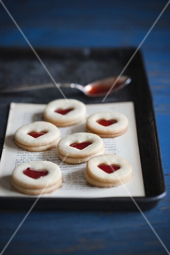 Jam Filled Heart Cookies on Paper on Pan