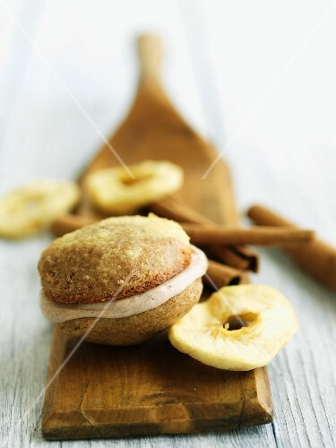 An apple and cinnamon whoopie pie with dried apples and cinnamon sticks